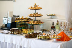 Stylish luxury tables with sweets for the celebration for a wedd Stock Images