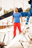 Stylish macho standing on white yacht Royalty Free Stock Photography