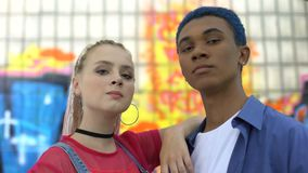 Stylish male and female teenagers looking camera, urban youth trends, subculture stock footage