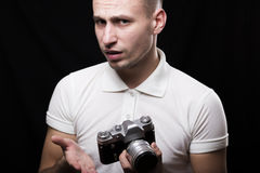 Stylish male photographer with a questioning expression on her f Stock Photography