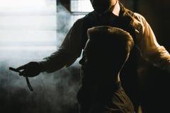 Stylish male shaving with dangerous sharp razor stock photography