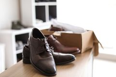 Stylish male shoes on counter. In store Royalty Free Stock Image