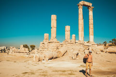 Stylish male tourist with backpack visit and exploring historic attraction. Man enjoy summer vacation. Sightseeing tour. Tourism i. Photo of the Stylish male Stock Image