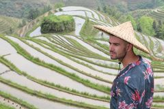 Stylish man in Asian rice terraces.  royalty free stock photos