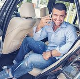 Stylish man on a back seat Royalty Free Stock Photo