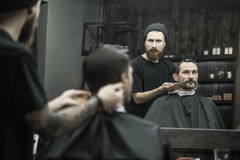 Stylish man in barbershop Royalty Free Stock Photo