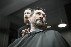 Stylish man in barbershop Royalty Free Stock Image