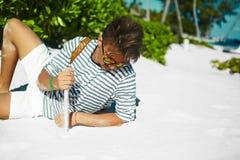 Stylish man on beach sand in sun glasses Royalty Free Stock Photo