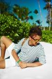 Stylish man on beach sand in sun glasses Stock Image