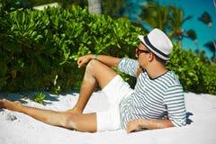 Stylish man on beach sand in sun glasses Stock Photography