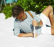 Stylish man on beach sand in sun glasses Royalty Free Stock Image