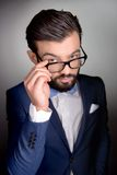 Stylish man with beard and glasses looking at Stock Photo