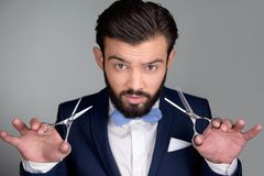 Stylish man with beard holding scissors Royalty Free Stock Images