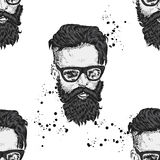 Stylish man with a beard. Man with long hair and glasses. Print on clothes. Barbershop. Royalty Free Stock Image