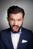Stylish man with beard screaming and looking at Royalty Free Stock Photos