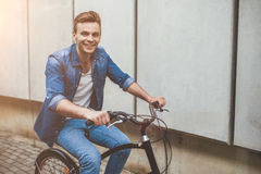Stylish man with bicycle in the city Stock Photo