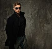 Stylish man in black coat Royalty Free Stock Image