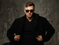 Stylish man in black coat Stock Photography