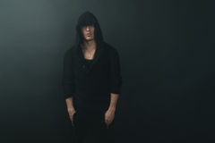 79a89d64527 Stylish man in black hoodie. Stylish man in a black hoodie stock image