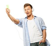 Stylish man in blue shirt doing selfie Stock Photography