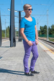 Stylish man  in blue standing on train station Royalty Free Stock Photos