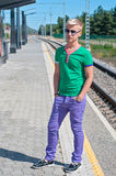 Stylish man in blue standing on train station Royalty Free Stock Photo