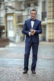 Stylish man in a blue suit royalty free stock image