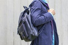 Stylish man in blue suit with leather backpack Stock Photo
