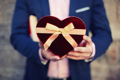 Stylish man in a blue suit to prepare a gift for your favorite Royalty Free Stock Images