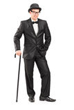 Stylish man with cane posing Stock Images