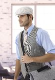 Stylish man in cap leaving office Stock Photography