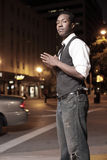 Stylish man in the city at night Stock Photos