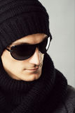 Stylish man in dark sunglasses and black clothing Stock Image