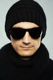 Stylish man in dark sunglasses and black clothing Royalty Free Stock Photography