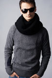 Stylish man in dark sunglasses and black scarf Stock Photos