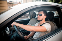 Stylish man driving car Stock Photography
