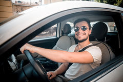 Stylish man driving car Royalty Free Stock Photos