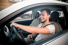 Stylish man driving car. In the city Royalty Free Stock Photography