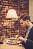Stylish man eating at restaurant. Stylish wealthy man eating at restaurant Royalty Free Stock Images