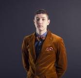 Stylish man in an elegant velvet suit. Royalty Free Stock Image