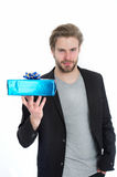 Stylish man with gift box or present for christmas Royalty Free Stock Image