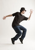 Stylish man in hat dancing