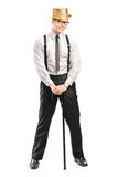 Stylish man with hat holding a cane Stock Photos