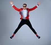 Stylish man having fun jumping Royalty Free Stock Image