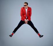 Stylish man having fun jumping Stock Photo