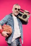 Stylish man holding basketball ball and tape recorder Stock Image