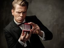 Stylish man holding box with a proposal ring Royalty Free Stock Photos