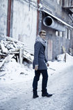 Stylish man in a jacket, sweater, scarf and glasse Stock Image