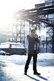 Stylish man in a jacket, sweater, scarf and glasse Stock Images