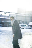 Stylish man in a jacket, sweater, scarf and glasse Royalty Free Stock Image